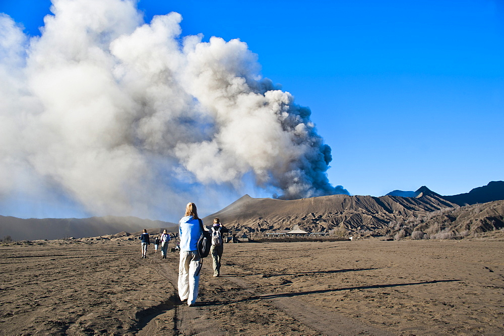 Tourists watching Mount Bromo, an active volcano, erupting in East Java, Indonesia, Southeast Asia, Asia