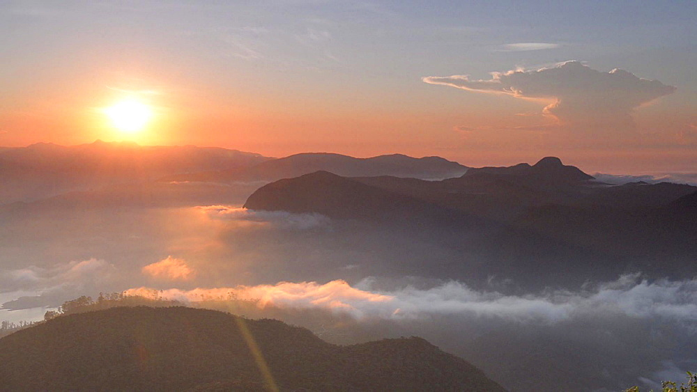 Time lapse of rolling clouds from the 2443m summit of Adams Peak (Sri Pada) at sunrise, Sri Lanka Highlands, Asia