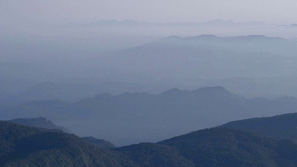 View of mountains from the 2443m summit of Adams Peak (Sri Pada) at sunrise, Sri Lanka Highlands, Asia