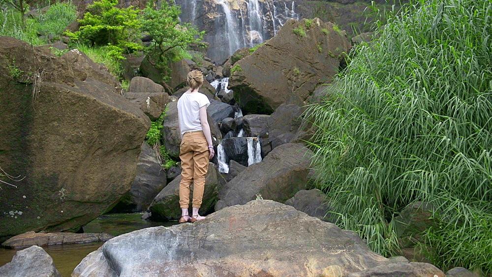 Tourist at Bambarakanda Falls, a waterfall near Haputale, Sri Lanka Hill Country, Nuwara Eliya District, Asia