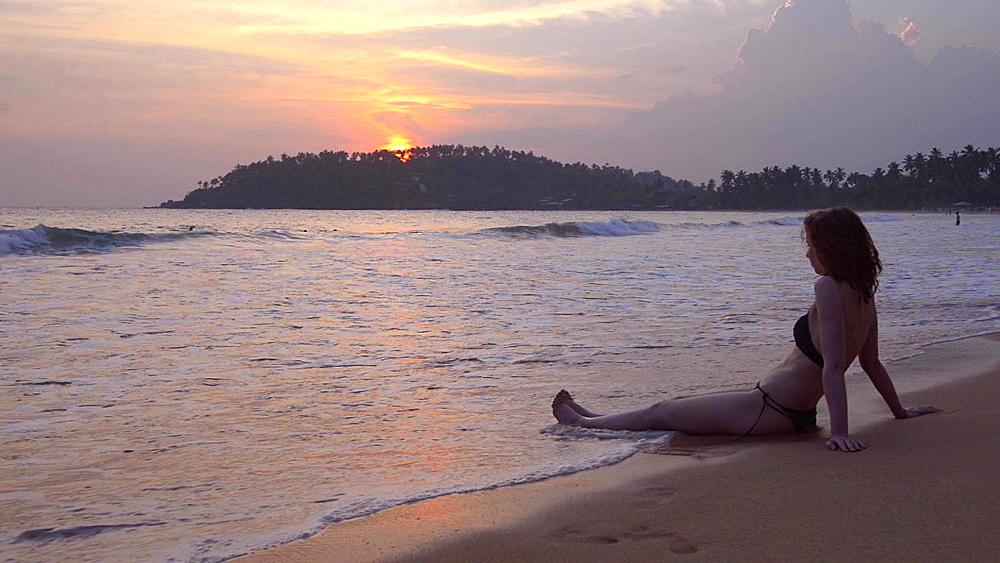 Mirissa Beach, tourist watching the sunset, South Coast of Sri Lanka, Southern Province, Asia