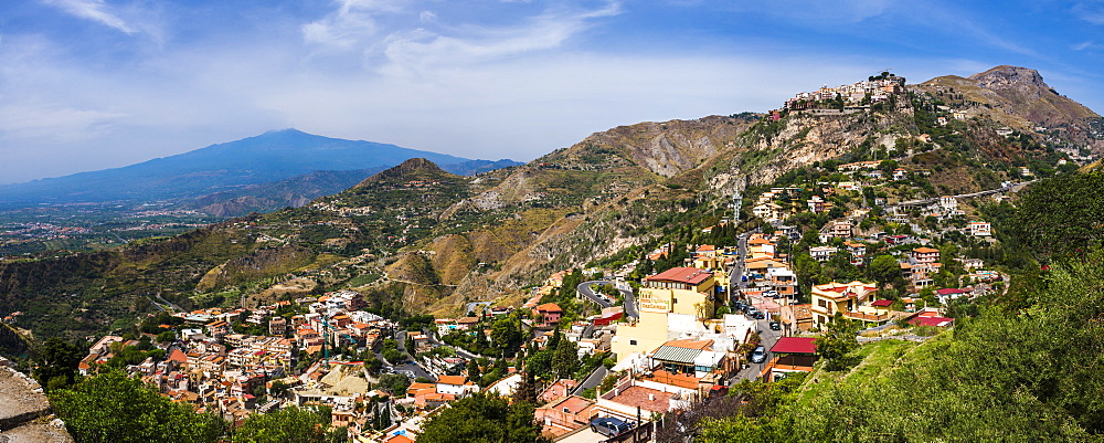 Taormina and Castelmola on the right, with Mount Etna in distance, Sicily, Italy, Europe