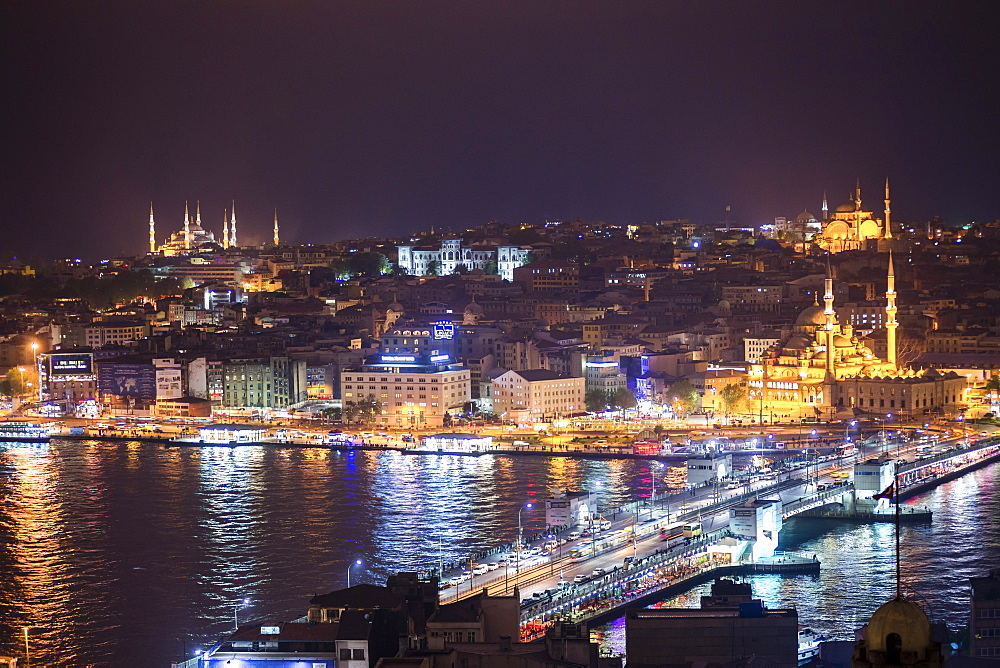 Istanbul at night, with Blue Mosque on left, New Mosque on right and Galata Bridge across Golden Horn, Turkey, Europe