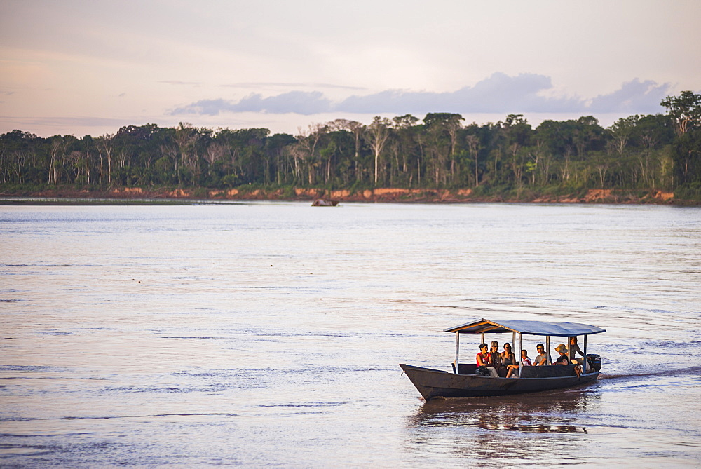 Amazon Jungle boat trip at sunset, Tambopata National Reserve, Peru, South America