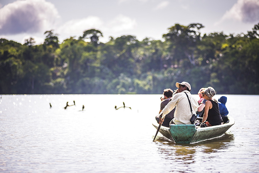 Canoe boat trip in Amazon Jungle of Peru, by Sandoval Lake in Tambopata National Reserve, Peru, South America