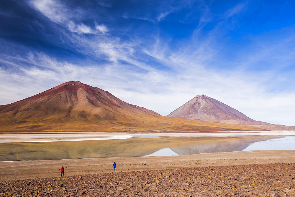 Tourists at Licancabur volcano on right and Laguna Verde, Bolivia near the border with Chile, Bolivia, South America