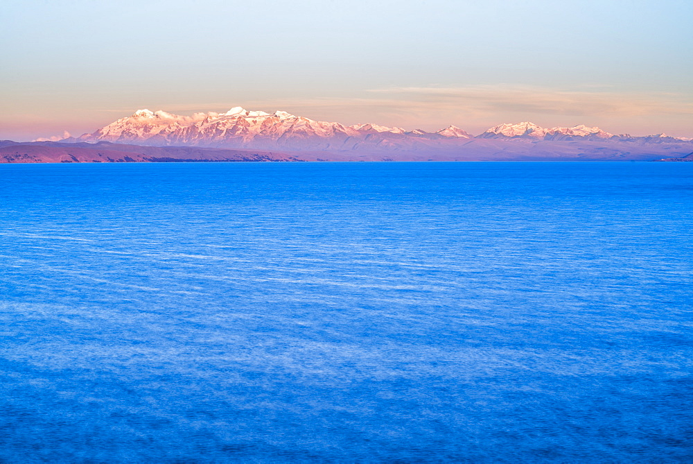 Cordillera Real Mountain Range, part of Andes Mountains, and Lake Titicaca at sunset, seen from Isla del Sol, Bolivia, South America