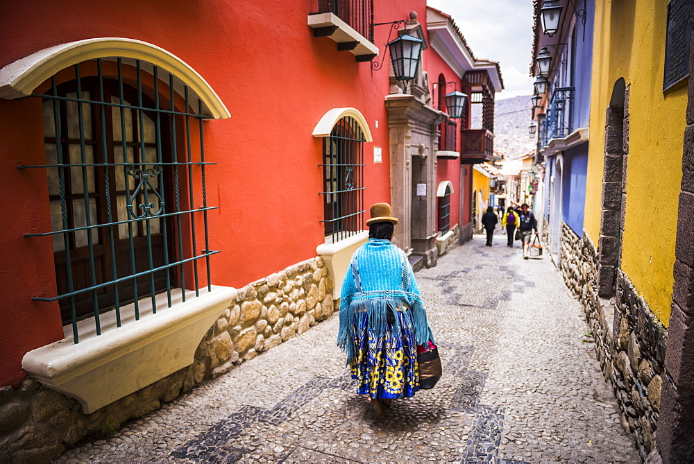 Chollita on Calle Jaen, a colourful colonial cobbled street in La Paz, La Paz Department, Bolivia, South America