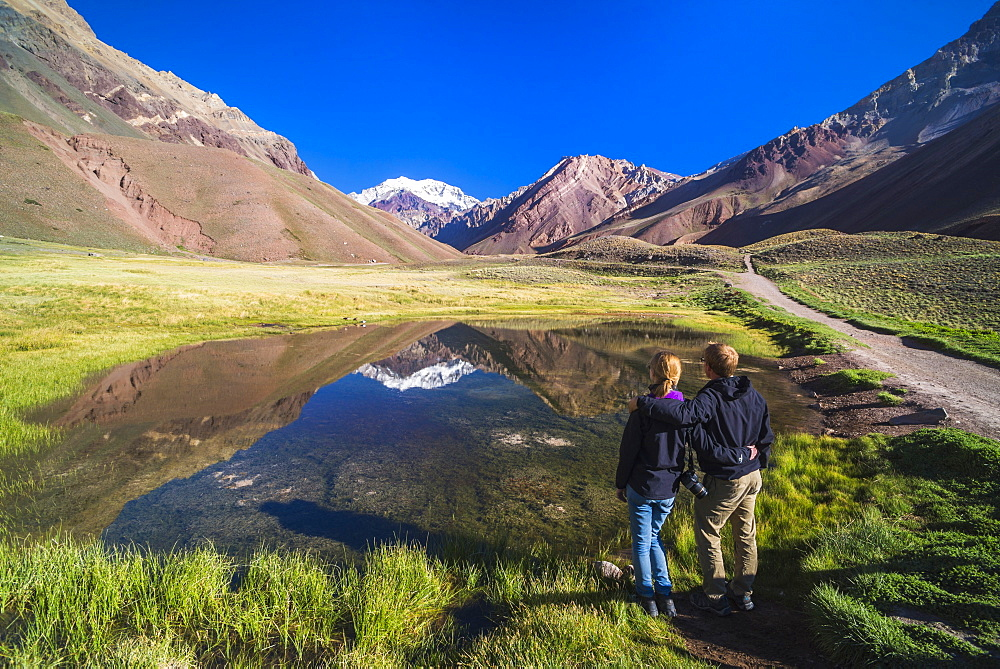 Trekking in Aconcagua Provincial Park with 6961m peak of Aconcagua behind, Andes, Mendoza Province, Argentina, South America