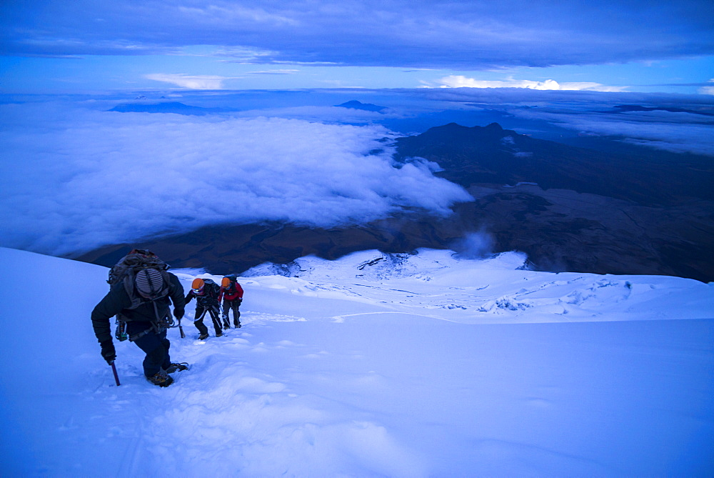 Climbers near the summit of Cotopaxi Volcano 5897m glacier covered summit, Cotopaxi National Park, Cotopaxi Province, Ecuador, South America