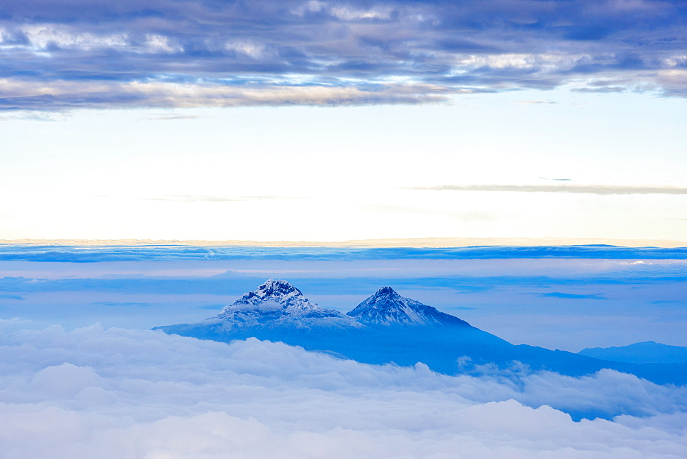 Volcanoes of Illiniza Norte, 5126m on left and Illiniza Sur, 5248m on right, seen from Cotopaxi Volcano 5897m summit, Cotopaxi Province, Ecuador, South America