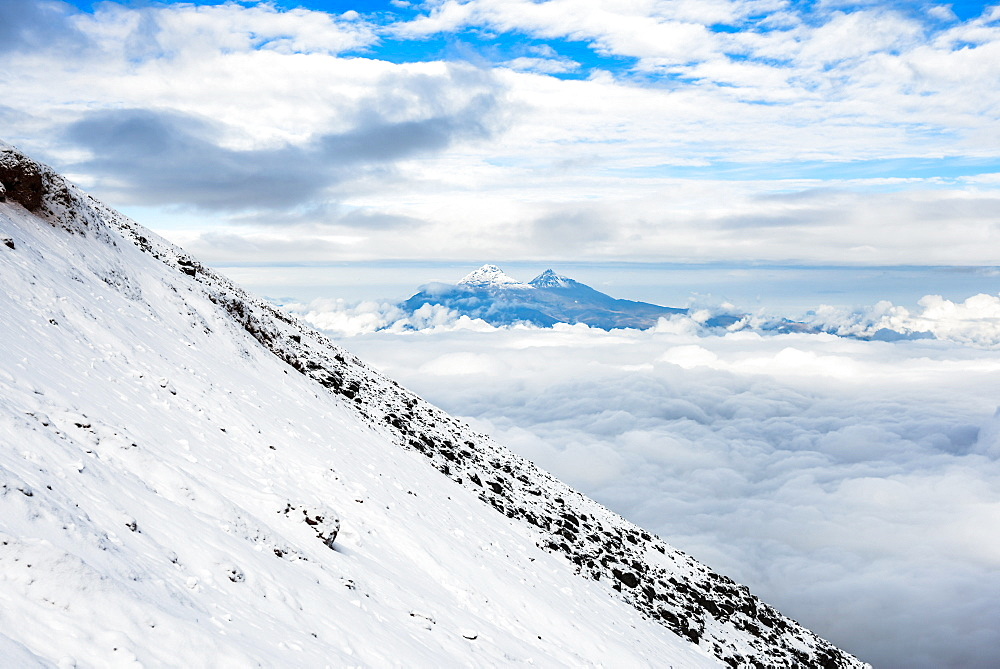 Volcanoes of Illiniza Norte, 5126m on left and Illiniza Sur, 5248m on right, seen from Cotopaxi Volcano, Cotopaxi Province, Ecuador, South America