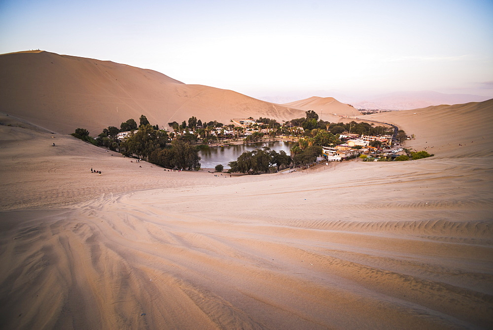 Huacachina and sand dunes at sunset in the desert in the Ica Region, Peru, South America