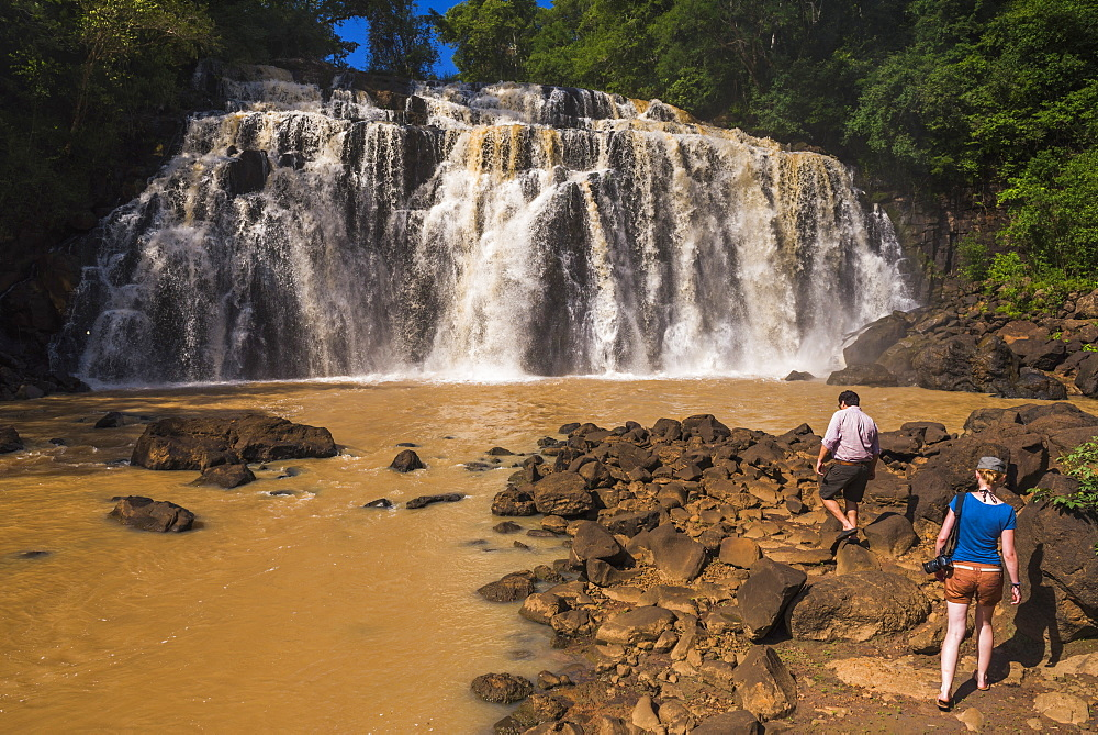 People at waterfall connecting a tributary with the Rio Parana (Parana River), near Puerto Iguazu, Misiones Province, Argentina, South America