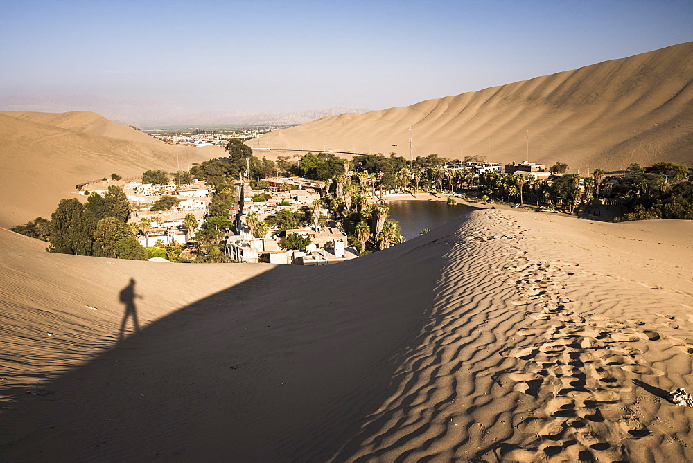 Climbing sand dunes at sunset at Huacachina, a village in the desert, Ica Region, Peru, South America