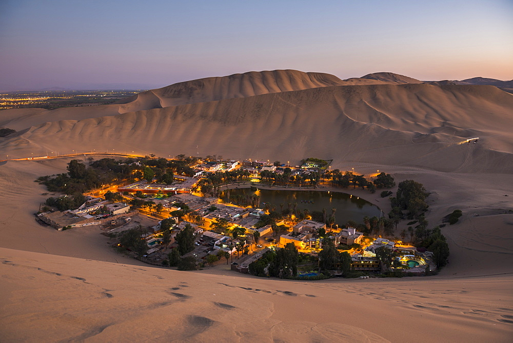 Huacachina, surrounded by sand dunes at night, Ica Region, Peru, South America