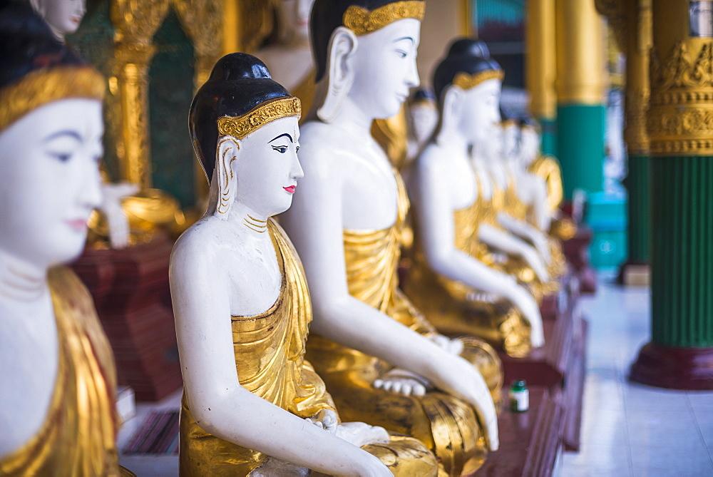 Buddha images at Shwedagon Pagoda (Shwedagon Zedi Daw) (Golden Pagoda), Yangon (Rangoon), Myanmar (Burma), Asia