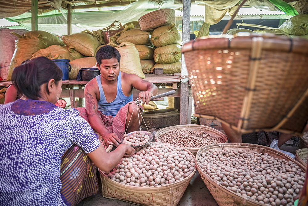 Weighing potatoes in Mrauk U vegetable market, Rakhine State, Myanmar (Burma), Asia