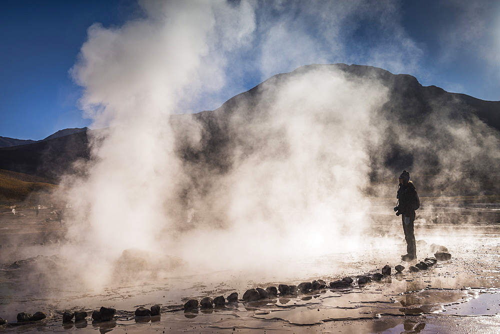 Tourist at El Tatio Geysers (Geysers del Tatio), the largest geyser field in the Southern Hemisphere, Atacama Desert, Chile, South America