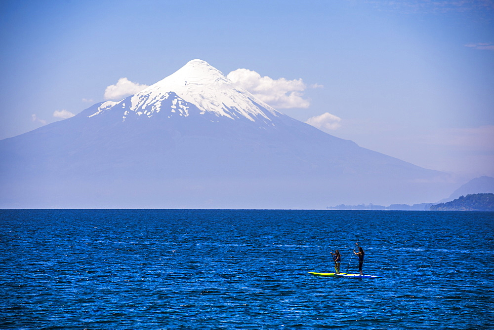 Paddleboarding on Llanquihue Lake with Osorno Volcano (Volcan Osorno) behind, Puerto Varas, Chile Lake District, Chile, South America