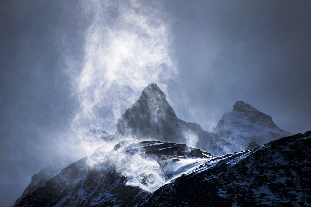 Wind sweeping snow off mountains, Torres del Paine National Park, Patagonia, Chile, South America