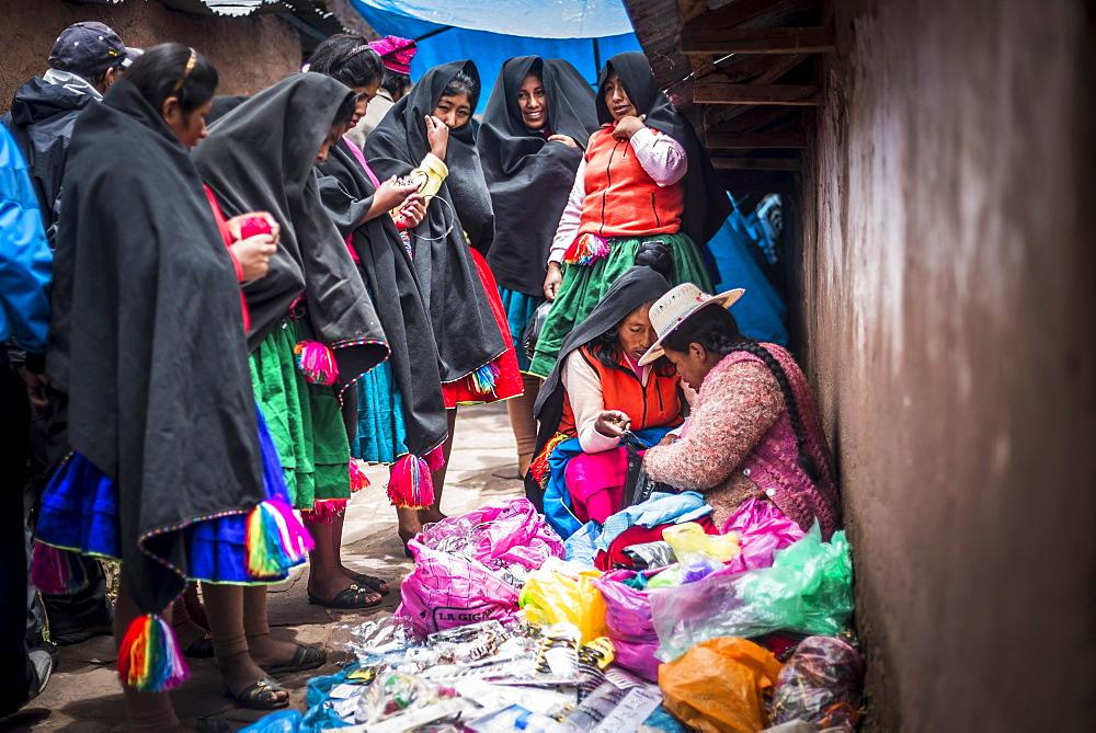 Traditional Peruvian Quechua women at Taquile Market on Taquile Island, Lake Titicaca, Peru, South America