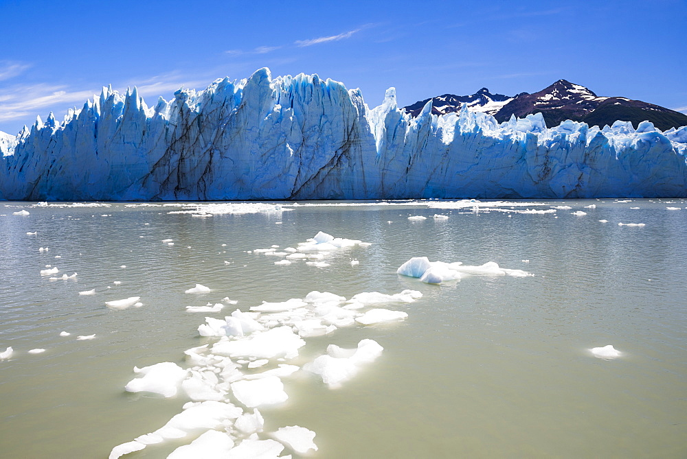 Fallen ice and Perito Moreno Glaciar, Los Glaciares National Park, UNESCO World Heritage Site, near El Calafate, Patagonia, Argentina, South America