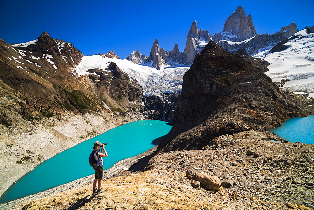 Hiker taking a photo of Mount Fitz Roy (Cerro Chalten), El Chalten, Patagonia, Argentina, South America