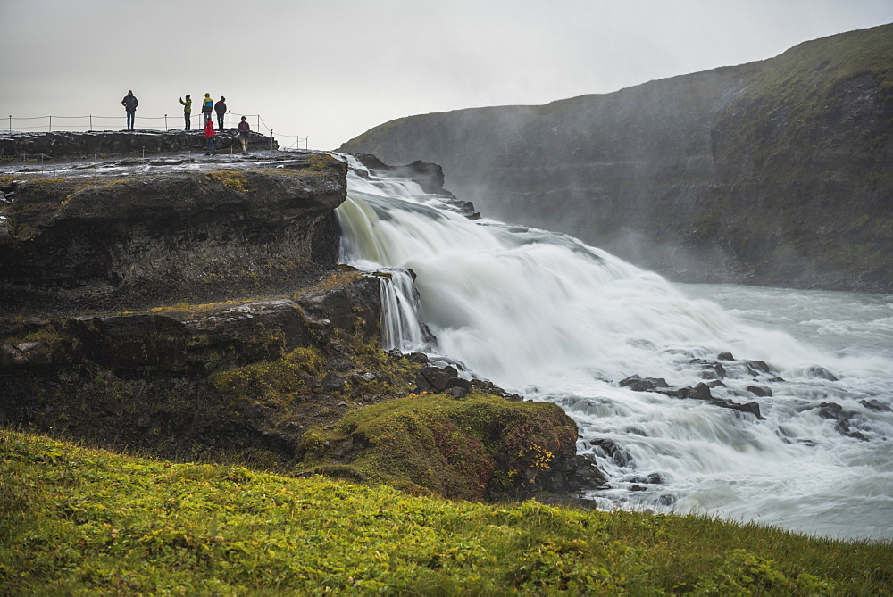 Tourists at Gullfoss Waterfall in the canyon of the Hvita River, The Golden Circle, Iceland, Polar Regions