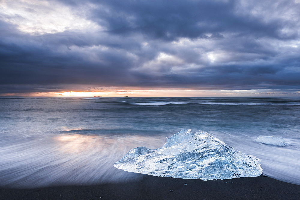 Iceberg at sunrise on Jokulsarlon Beach, a black volcanic sand beach in South East Iceland, Iceland, Polar Regions
