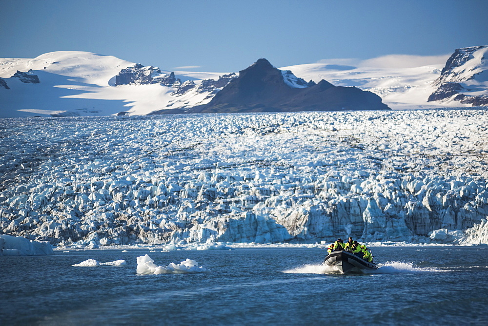 Zodiac boat tour on Jokulsarlon Glacier Lagoon, with Breidamerkurjokull Glacier and Vatnajokull Ice Cap behind, South East Iceland, Iceland, Polar Regions