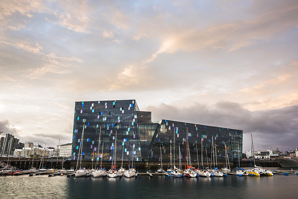 Harpa Concert Hall and Conference Centre and boats in Reykjavik Harbour at sunrise, Iceland, Polar Regions
