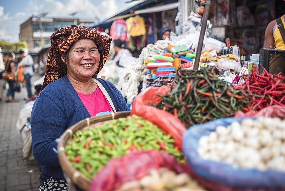 Portrait of a market stall owner in Berastagi (Brastagi) Market, North Sumatra, Indonesia, Southeast Asia, Asia