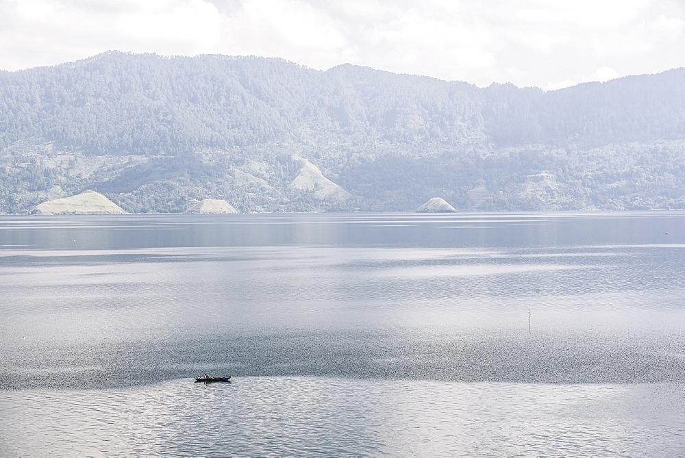 Fishing boat on Lake Toba (Danau Toba), the largest volcanic lake in the world, North Sumatra, Indonesia, Southeast Asia, Asia