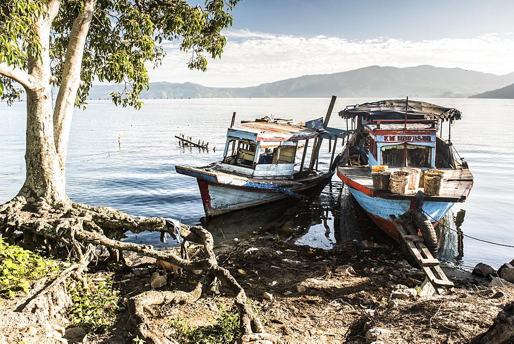 Old rusty fishing boats in a village at Lake Toba (Danau Toba), North Sumatra, Indonesia, Southeast Asia, Asia