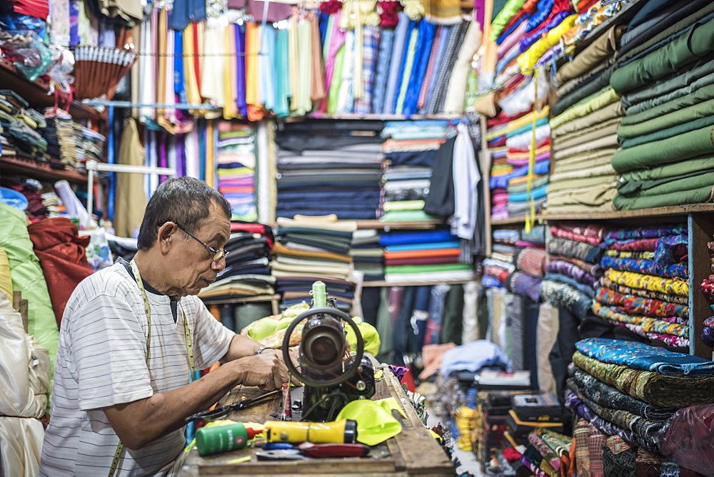 Man sewing in Sabang Market, Pulau Weh Island, Aceh Province, Sumatra, Indonesia, Southeast Asia, Asia