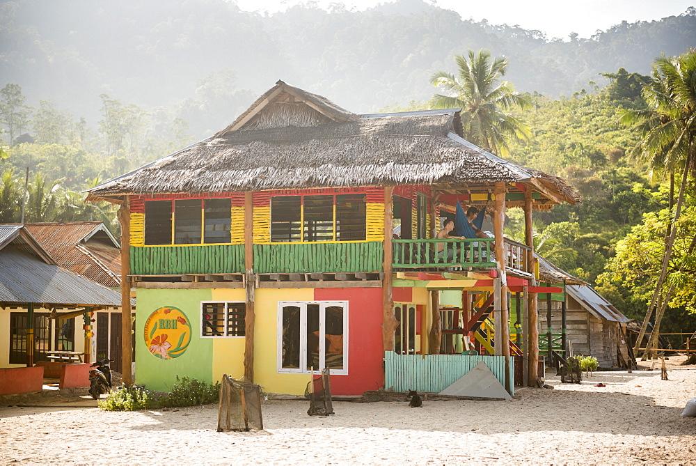 Rasta (Rastafarian) coloured beachfront accommodation at Sungai Pinang, near Padang in West Sumatra, Indonesia, Southeast Asia, Asia