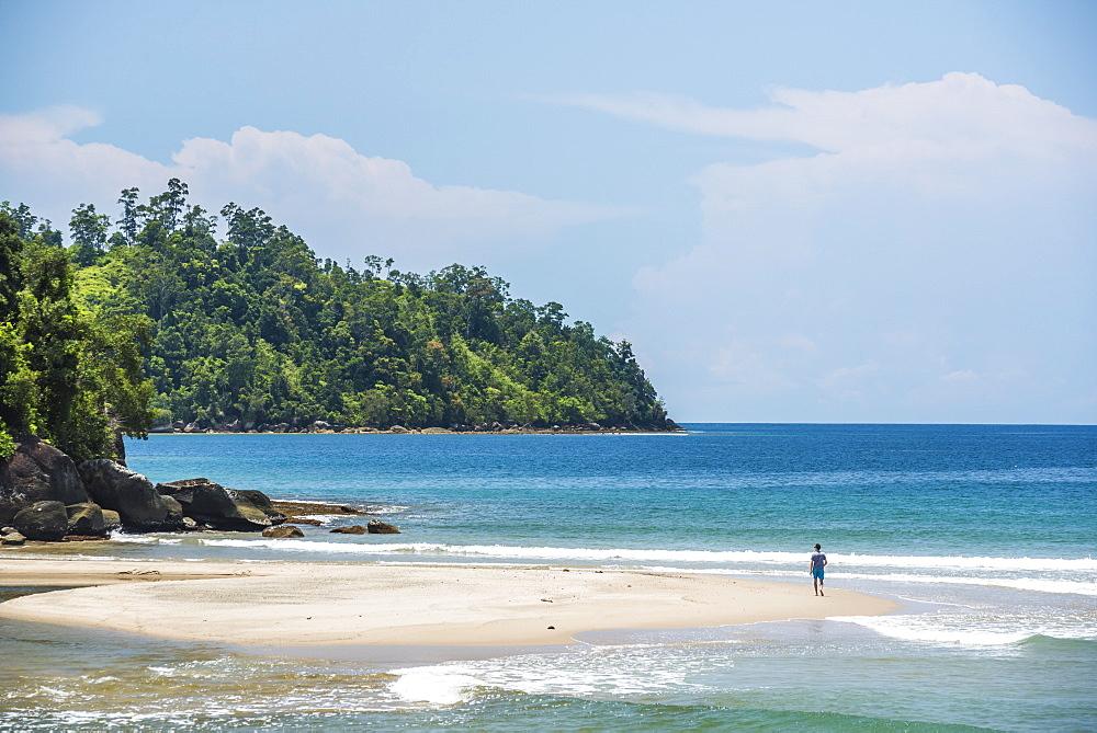 Tourist walking on Sungai Pinang Beach, near Padang in West Sumatra, Indonesia, Southeast Asia, Asia