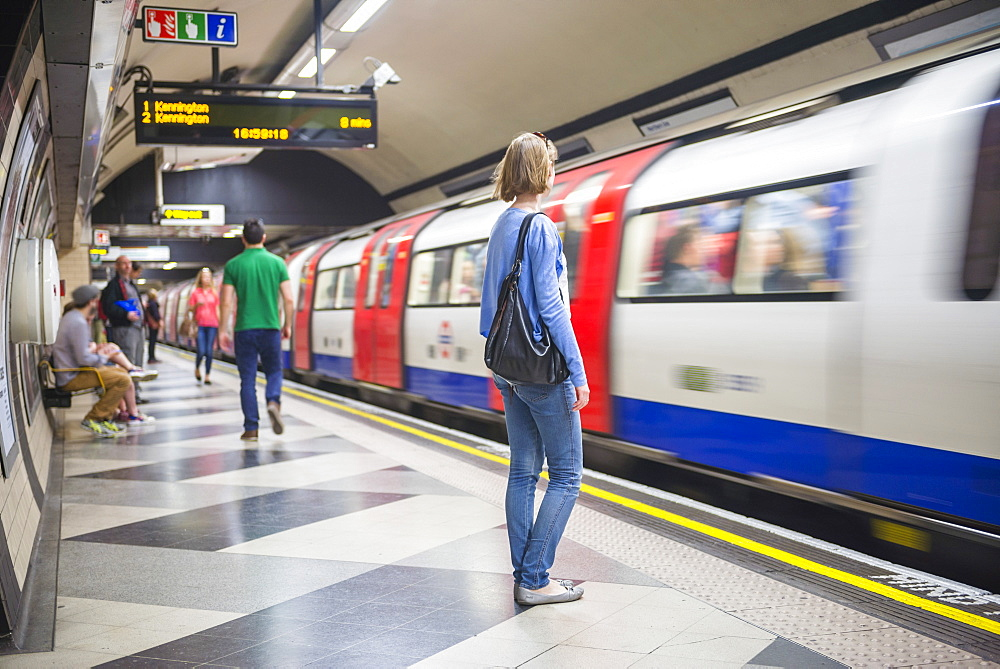 Person waiting at Waterloo underground station for the tube, London, England, United Kingdom, Europe