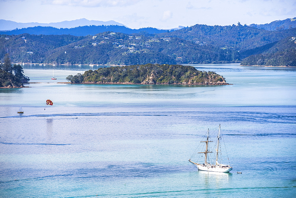 Sailing boat in the Bay of Islands seen from Russell, Northland Region, North Island, New Zealand, Pacific