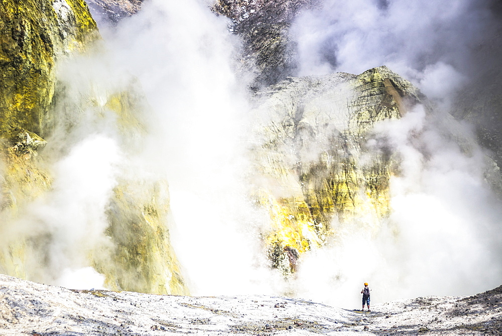 Tourist exploring White Island Volcano, an active volcano in the Bay of Plenty, North Island, New Zealand, Pacific