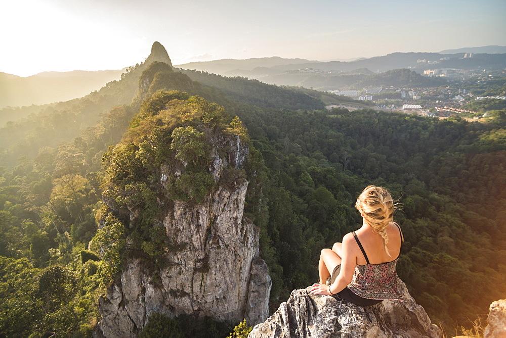 Tourist on Bukit Tabur Mountain at sunrise, Kuala Lumpur, Malaysia, Southeast Asia, Asia