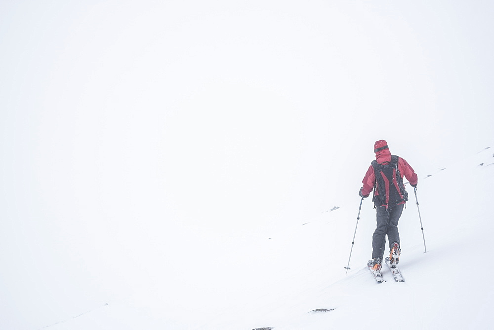 Ski touring in a snow blizzard white out at CairnGorm Mountain Ski Resort, Cairngorms National Park, Scotland, United Kingdom, Europe - 1109-3125