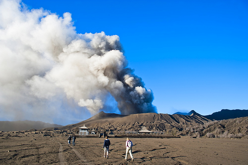 Tourists watching Mount Bromo volcanic eruption, East Java, Indonesia, Southeast Asia, Asia
