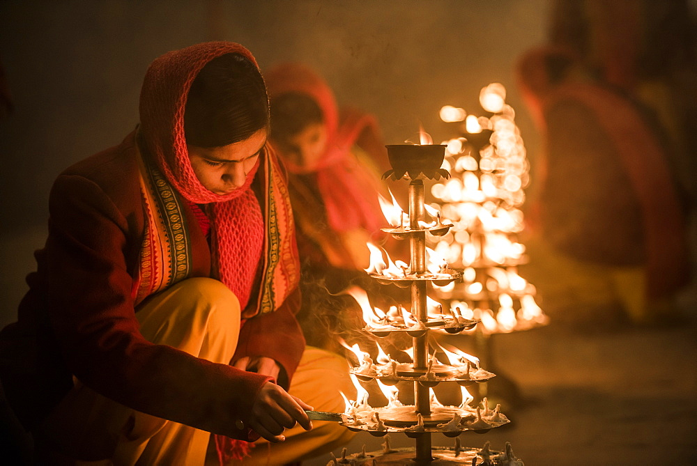 Ganga Aarti Hindu ceremony at Assi Ghat at dawn, Varanasi, Uttar Pradesh, India, Asia