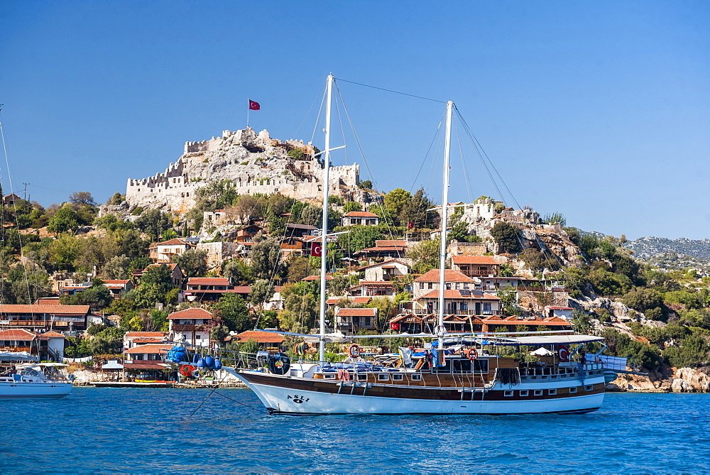 Simena Castle and Gulet sailing boat seen from Kekova Bay, Antalya Province, Lycia, Anatolia, Mediterranean Sea, Turkey, Asia Minor, Eurasia