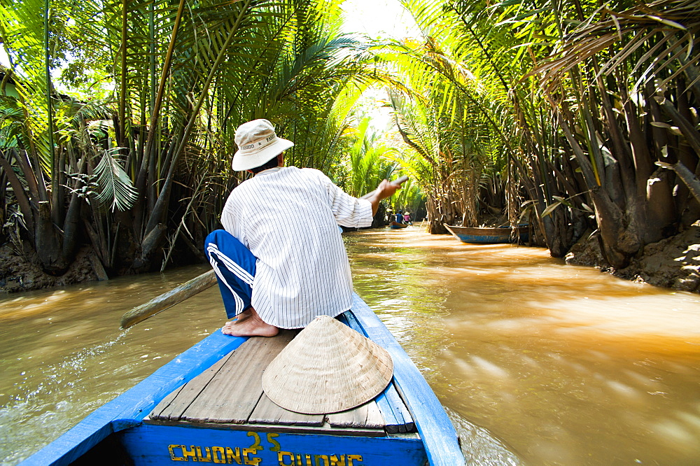 Boat trip up a narrow river in the Mekong Delta, Vietnam, Indochina, Southeast Asia, Asia