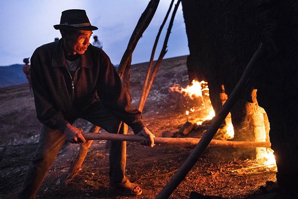 Brick workers firing a kiln near Antsirabe, Vakinankaratra Region, Madagascar, Africa - 1109-3548