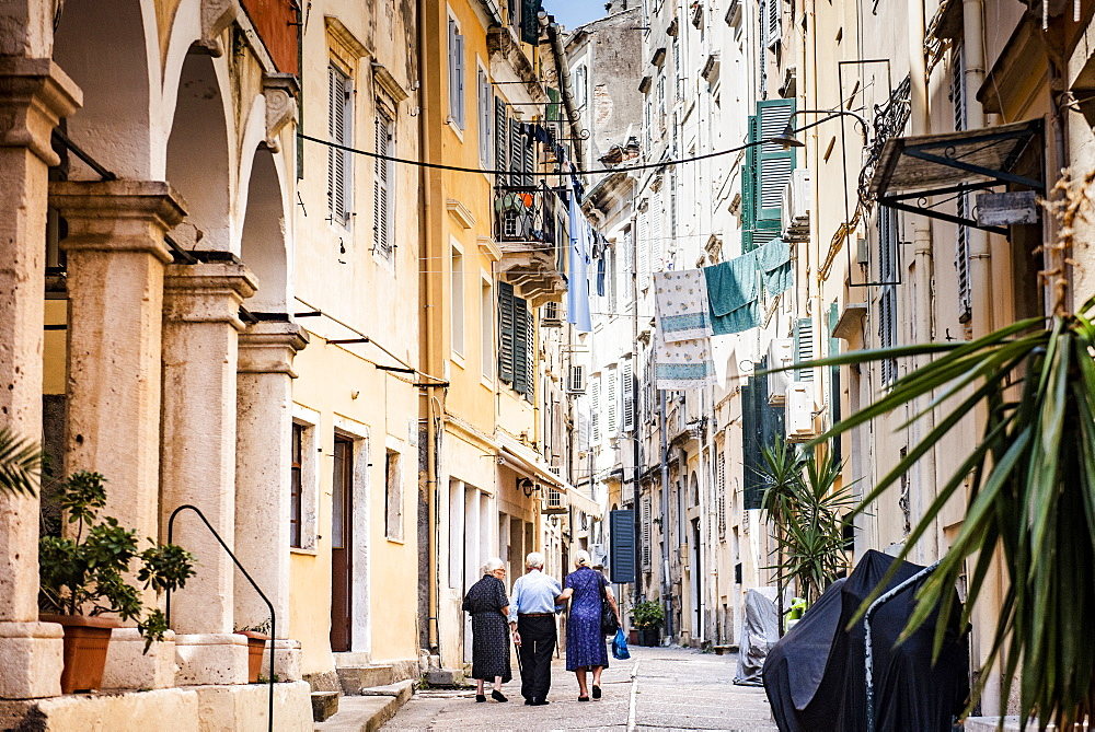 People walking along alley in old town of Corfu, Corfu Island, Ionian Islands, Greece, Europe
