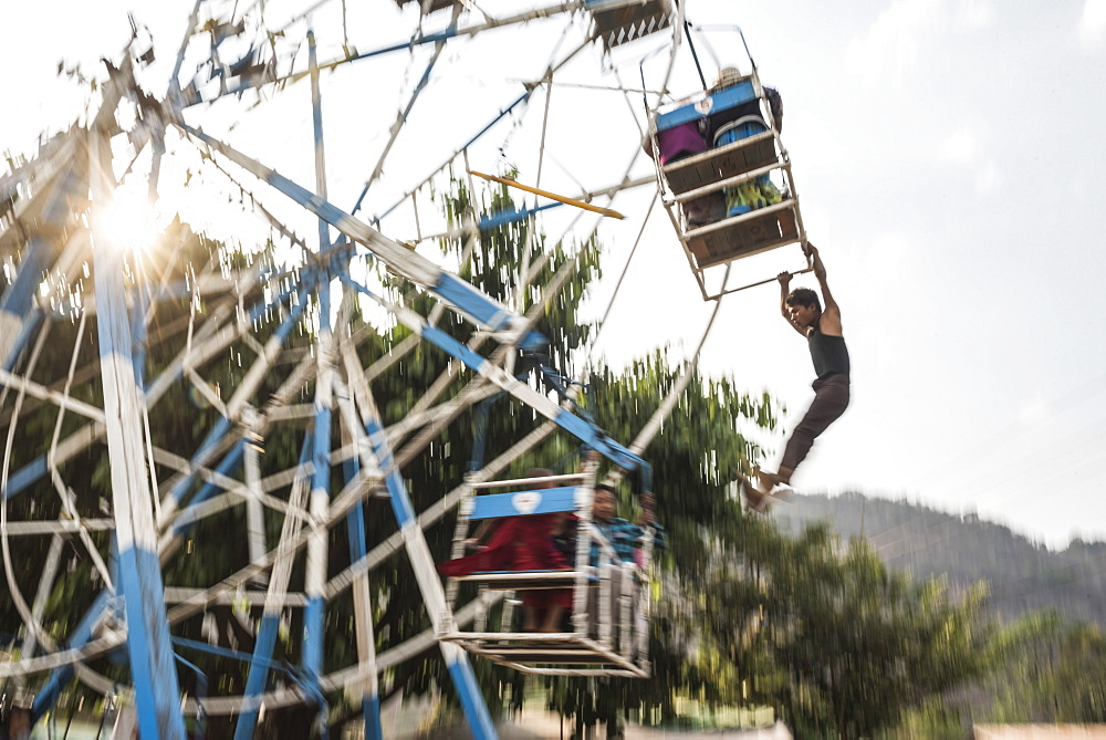 Hand operated ferris wheel at Pindaya Cave Festival, Shan State, Myanmar - 1109-3698